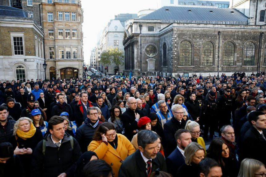 Members of the public attend a vigil to pay tribute to victims of the London Bridge terror attack in London on Dec 2, 2019.