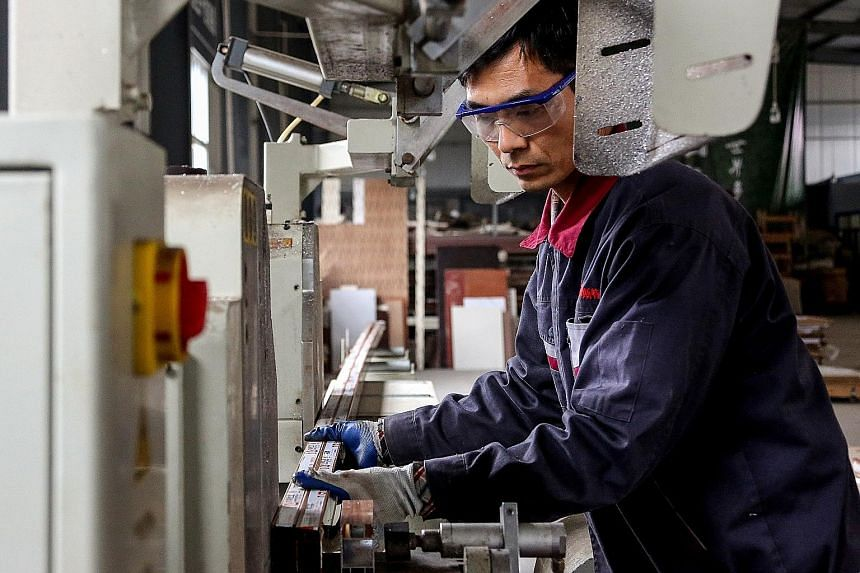 An employee working on aluminium products at a factory in Shandong province last month. Though Chinese factory activity has picked up, economists say much depends on how the ongoing US-China trade talks play out and how sustained the upswing in China