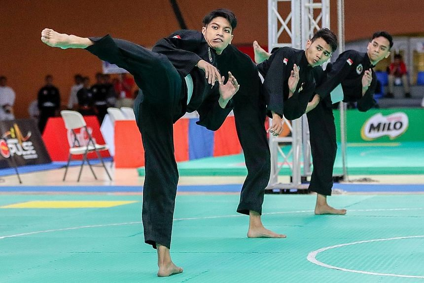 From far left: Nazrul Kamal, Nujaid Hasif, Hamillatu Arash won the men's seni regu team gold, Singapore's first in the artistic event. The trio were champions for the first time yesterday, at the Subic Bay Exhibition and Convention Centre in Manila,