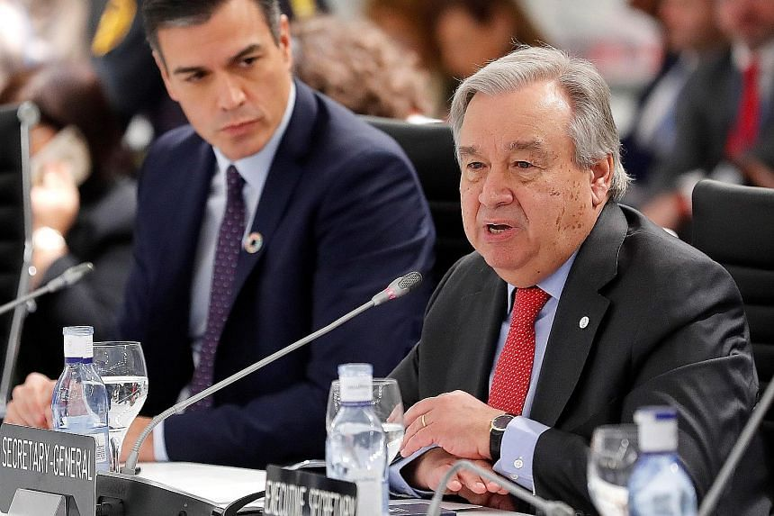UN chief Antonio Guterres speaking yesterday at the conference in Madrid. Beside him is Spain's acting Prime Minister Pedro Sanchez.