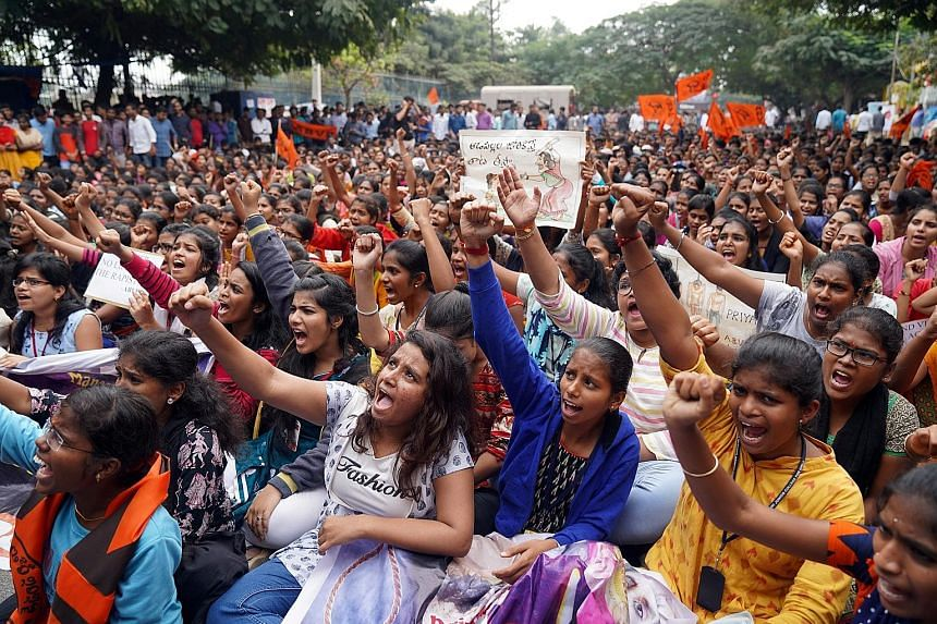 Protesters shouting slogans yesterday over the case of a 27-year-old veterinarian who was gang-raped and killed in Hyderabad last week.