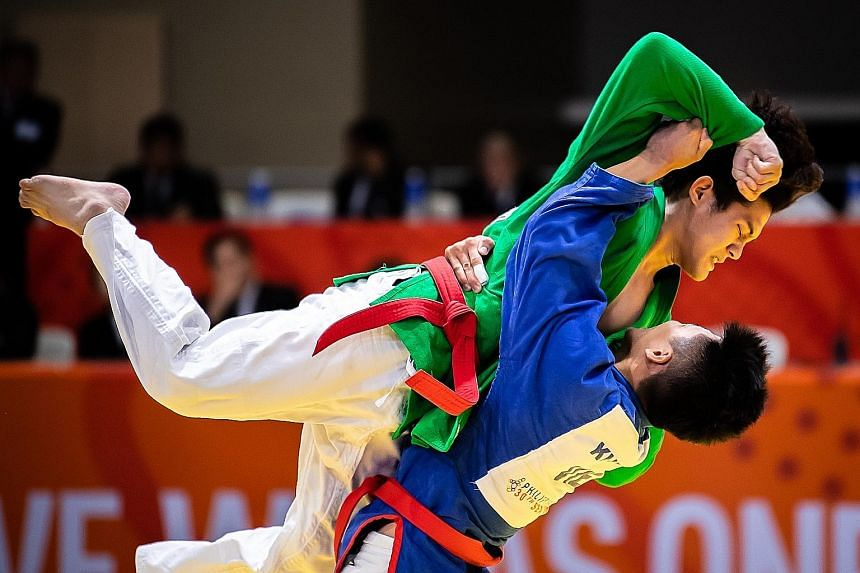 Joel Tseng (in green top) was outfought by eventual gold medallist Vu Ngoc Son of Vietnam. The Singaporean took the kurash under-73kg silver with two wins and two losses in the five-man round-robin competition.