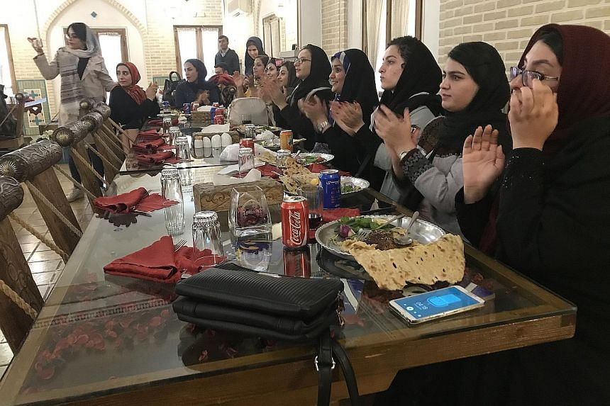 A group of Iranian women enjoying a meal and music in a restaurant in the city of Esfahan. Some women in Iran are again beginning to question why they should be forced to wear the hijab, which became compulsory after the Islamic Revolution in 1979. S