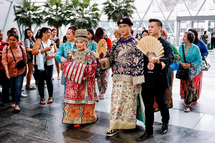 The couple, software programmer Huang Wen, 26, and engineer Laurie Huang, 27, wore traditional Peranakan wedding outfits for the ceremony, and were covered in the family's jewellery. Mr Huang was born in the United States, but both his parents are of