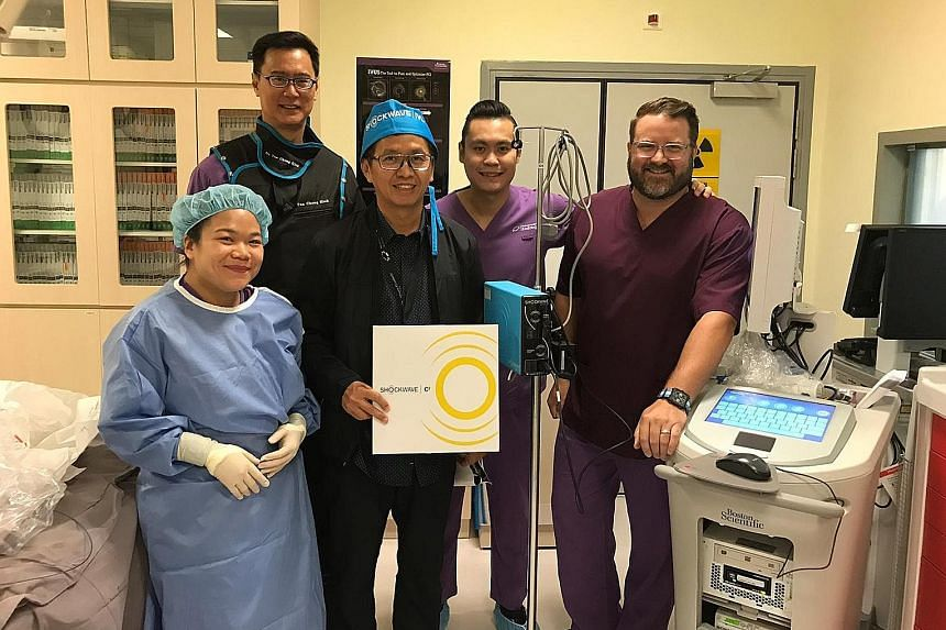 Dr Tan Chong Hiok (second from left), a cardiologist at Mount Elizabeth Hospital, has treated three patients using the new intravascular lithotripsy (IVL) device. With him are (from left) staff nurse Koo Suet Teng and cardiologist Chuang Hsuan Hung f