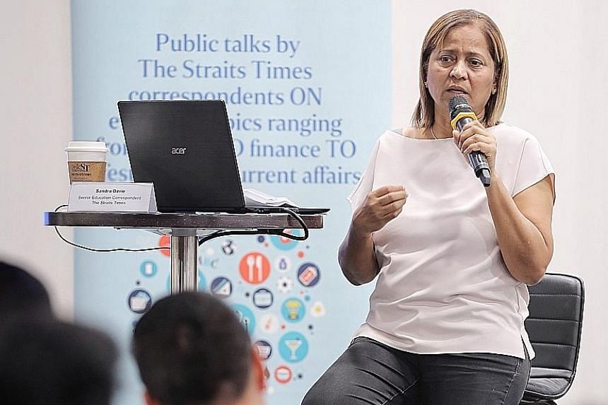 Straits Times senior education correspondent Sandra Davie speaking at an askST@NLB session last Friday at the Central Public Library. During the session, she explained the recent changes to the education system.