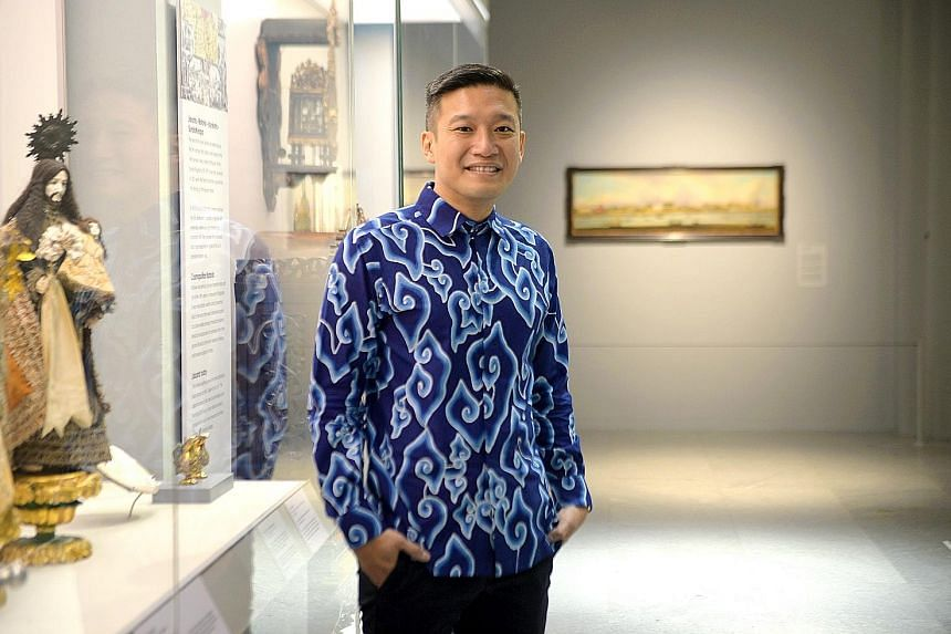 Mr Kennie Ting (above) at the Asian Civilisations Museum, which is increasingly seen as a one-stop shop for other museums to borrow objects. Besides holding blockbuster exhibitions, such as the Guo Pei: Chinese Art And Couture show (above), the Asian