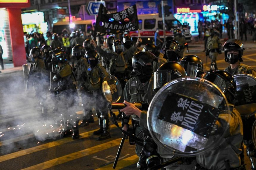 Police fire tear gas during a protest at Hung Hom area in Hong Kong on Dec 1, 2019.