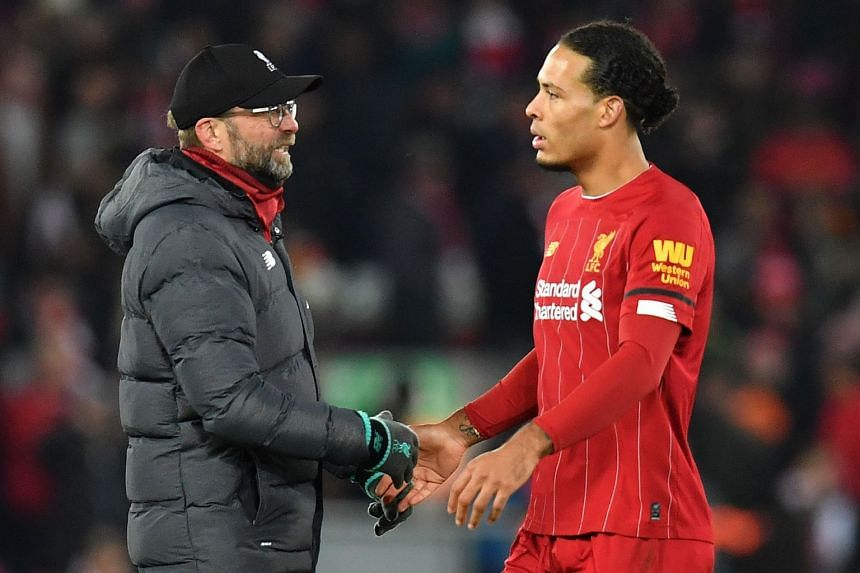 Klopp (left) talks with van Dijk following a match against Brighton at Anfield.