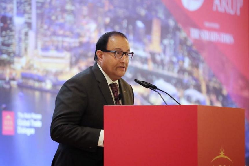In a photo taken on Nov 7, 2019, Communications and Information Minister S Iswaran speaking during the Asia House Global Trade Dialogue at Mandarin Oriental hotel.
