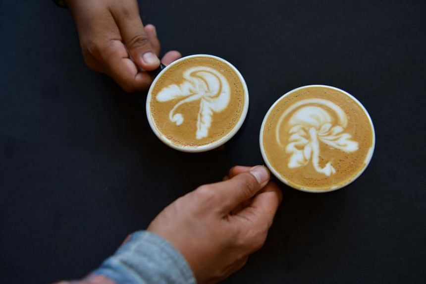 In a photo taken on Oct 20, 2019, latte coffee baristas compete in a contest at the Aceh Coffee Festival in Banda Aceh.