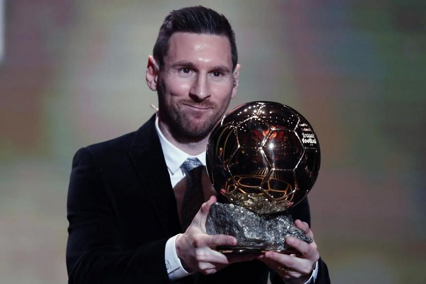Barcelona FC player Lionel Messi holds the trophy of the Golden Ball award ceremony in Paris on Dec 2, 2019.
