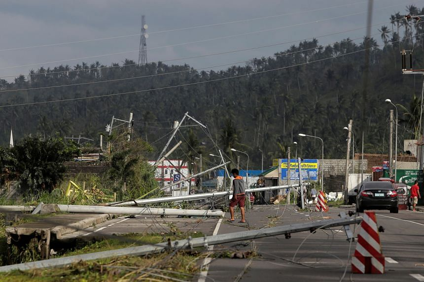 Damaged electric poles in Camalig town, the Philippines, on Dec 3, after Typhoon Kammuri hit.