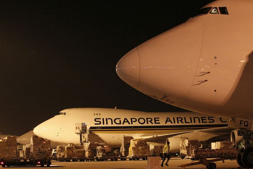 In this file picture, Singapore Airlines Boeing 747 freighter aircraft are seen parked at Changi Airport.