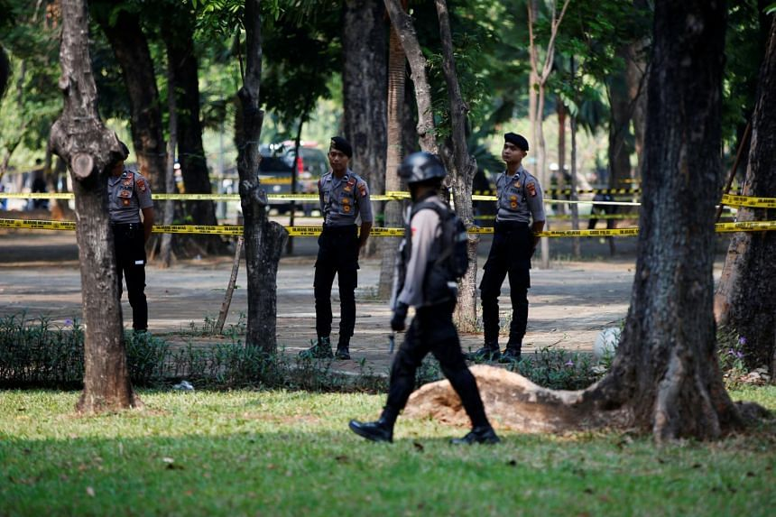 Indonesian police officers stand guard following a blast at the National Monument complex in Jakarta on Dec 3, 2019.