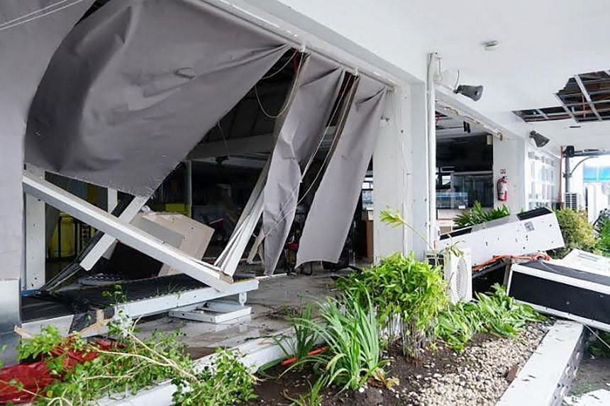 The destroyed wall of the passenger terminal in Legaspi City, Albay province, south of Manila, on Dec 3, 2019, after Typhoon Kamurri battered the province.