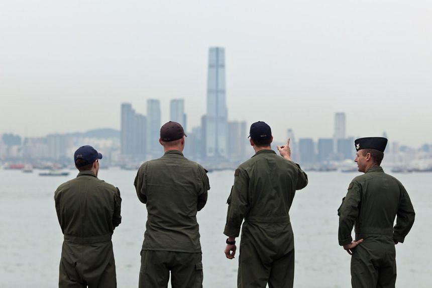 This photo taken on Aug 20, 2014, shows US Navy personnel on board the USS Makin Island looking towards the ICC building during a port-of-call visit to Hong Kong.