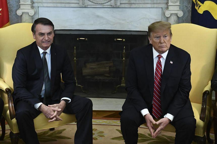 US President Donald Trump's (right) latest tariff announcement suggests Brazil President Jair Bolsonaro's US overtures have fallen on deaf ears.