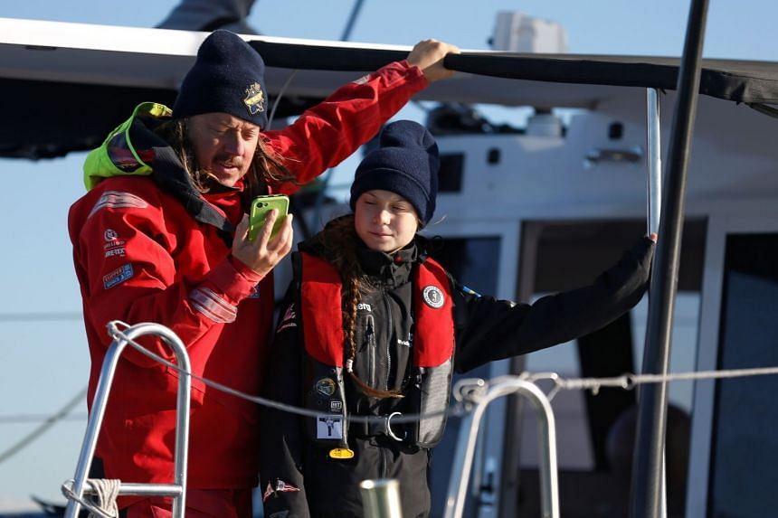Climate change activist Greta Thunberg and her father Svante arrive in Lisbon via yacht on Dec 3, 2019.
