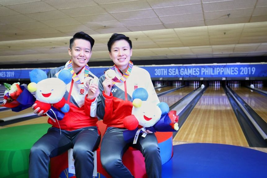 Team Singapore bowler New Hui Fen (right) won gold while teammate Shayna Ng claimed a bronze in the women's singles.