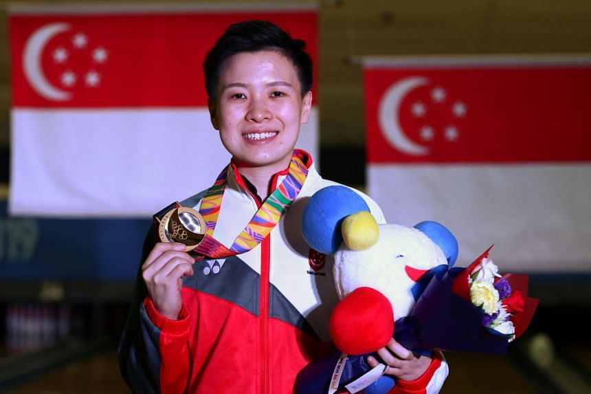 New Hui Fen struck gold at the 30th SEA Games after scoring a total of 1,372 pinfalls to finish first in the women's singles.