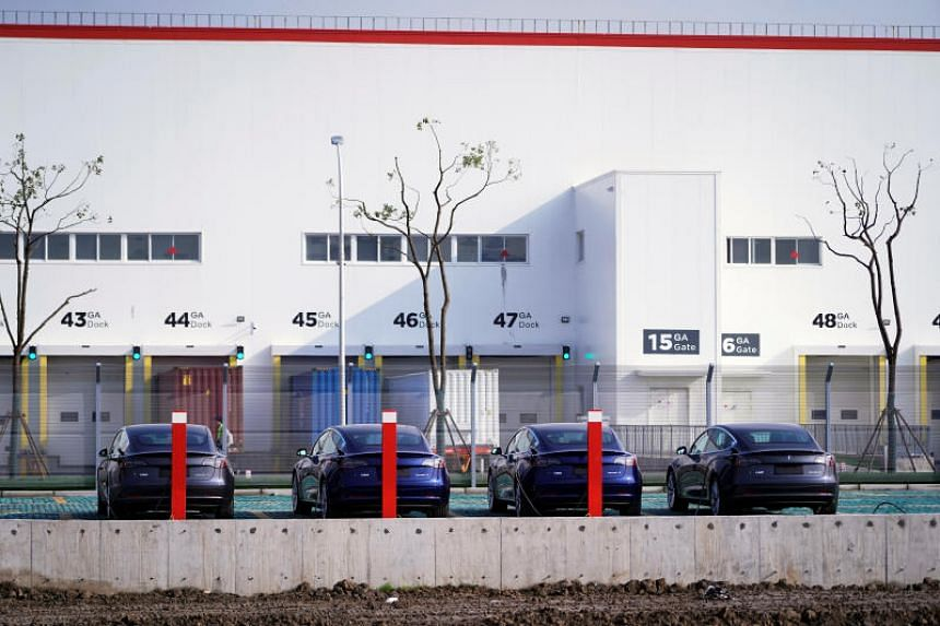 China-made Tesla Model 3 electric vehicles are seen at the  Tesla Gigafactory in Shanghai on Dec 2, 2019.