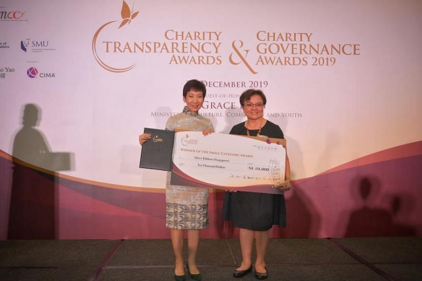 Minister for Culture, Community and Youth Grace Fu (left) presenting the Charity Governance Award for small charities to Silver Ribbon (Singapore) president Ellen Lee.