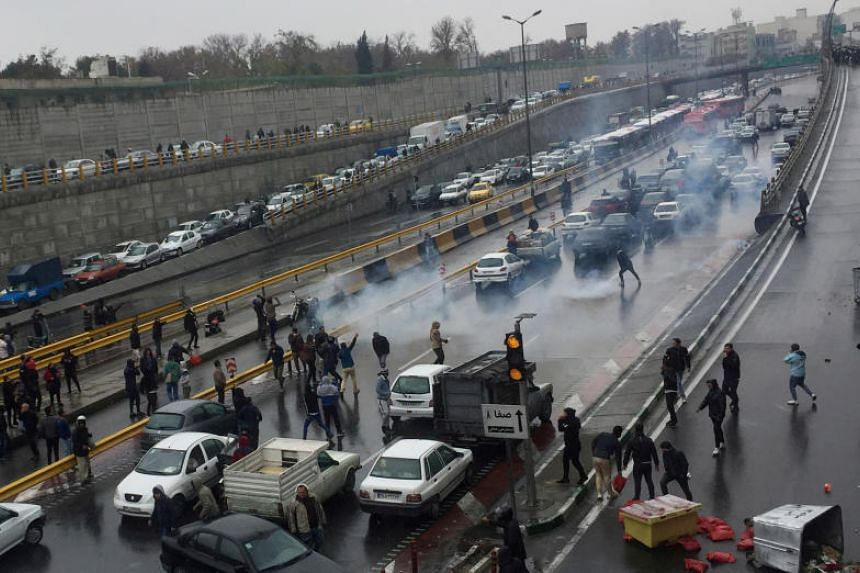 People protest against increased gas prices on a highway in Tehran, Iran, on Nov 16, 2019.