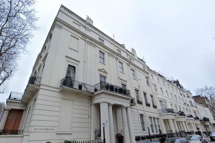 Britain's National Crime Agency said it had agreed a settlement in which Malik Riaz Hussain would hand over 1 Hyde Park Place and cash frozen in British bank accounts.