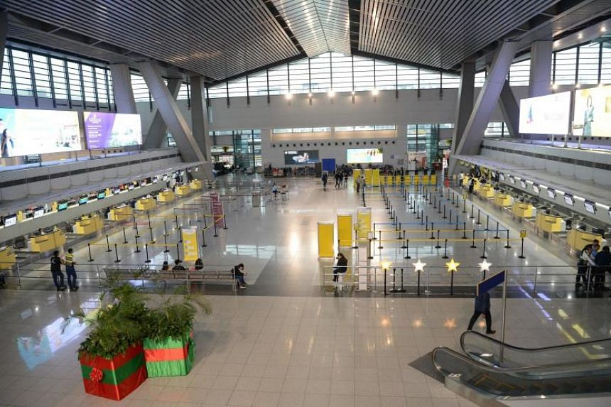 Empty airline check-in counters are seen inside Manila international Airport on Dec 3, 2019.