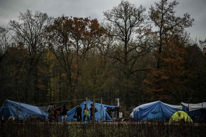 Tibetan asylum seekers are seen in a makeshift camp set up in Acheres, France, on Dec 2, 2019.