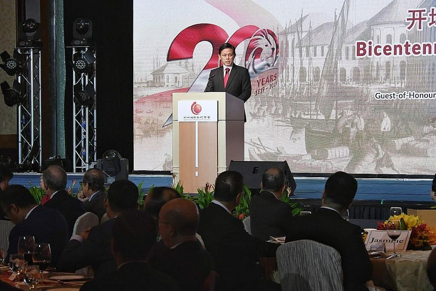 Minister for Trade and Industry Chan Chun Sing speaking at a bicentennial commemoration dinner organised by the Singapore Chinese Chamber of Commerce and Industry at Shangri-La Hotel yesterday. He urged employers to continue to commit to fair and pro
