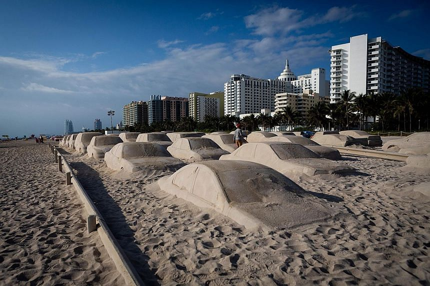 More than 60 car sand sculptures are drawing attention at the Art Basel international festival.