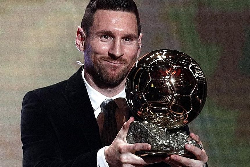 Lionel Messi, 32, is all smiles after picking up his sixth Ballon d'Or award in Paris on Monday night.