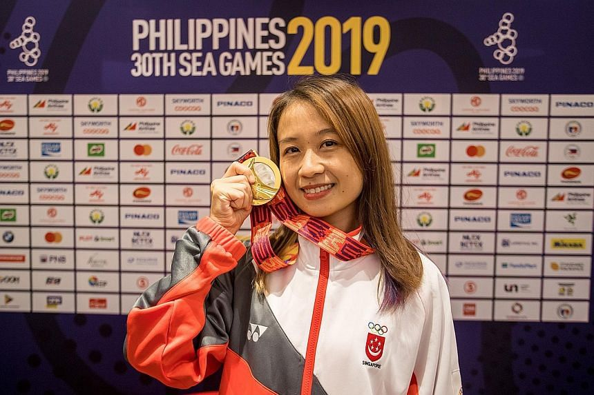 Gong Qianyun posing with her gold medal after emerging top of the women's rapid chess category yesterday. In the lead-up to the SEA Games, she was coaching more than 10 primary school pupils and practising two to three hours on a daily basis. PHOTO: