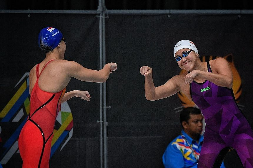 Amanda Lim (left) and Quah Ting Wen sharing a personalised fist bump at the 2017 SEA Games, where the team clinched their best away haul of 19 golds.