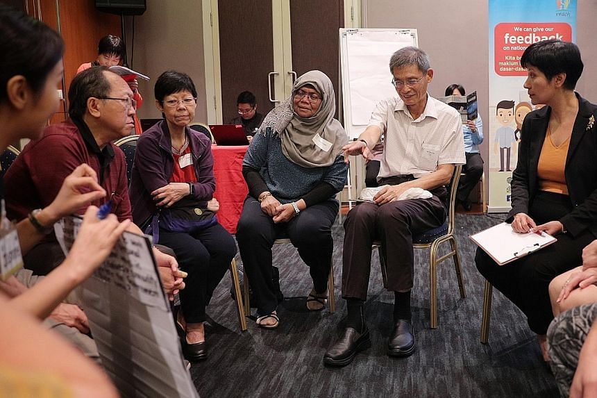 Second Minister for Finance Indranee Rajah (far right) joining in a small-group discussion during a pre-Budget dialogue yesterday. ST PHOTO: JASON QUAH