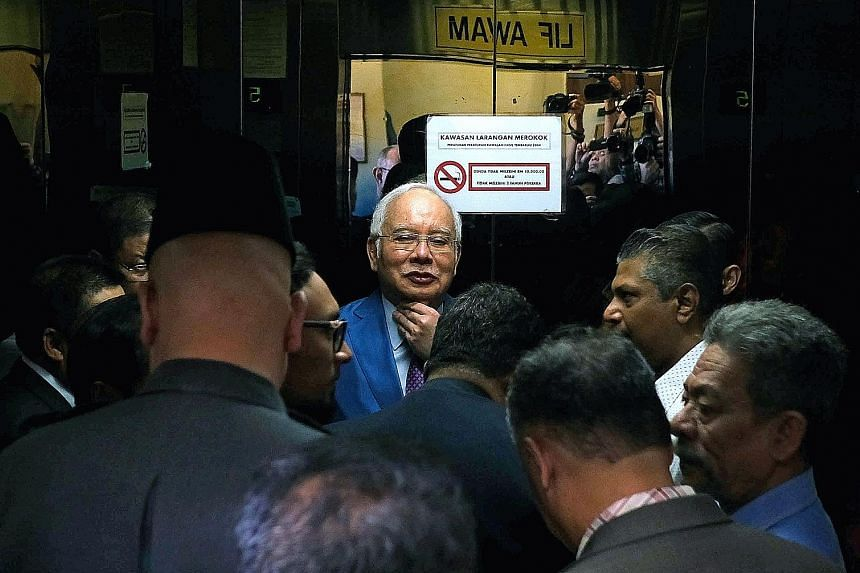 Malaysia's former prime minister Najib Razak arriving at the Kuala Lumpur Courts Complex yesterday. PHOTO: BLOOMBERG