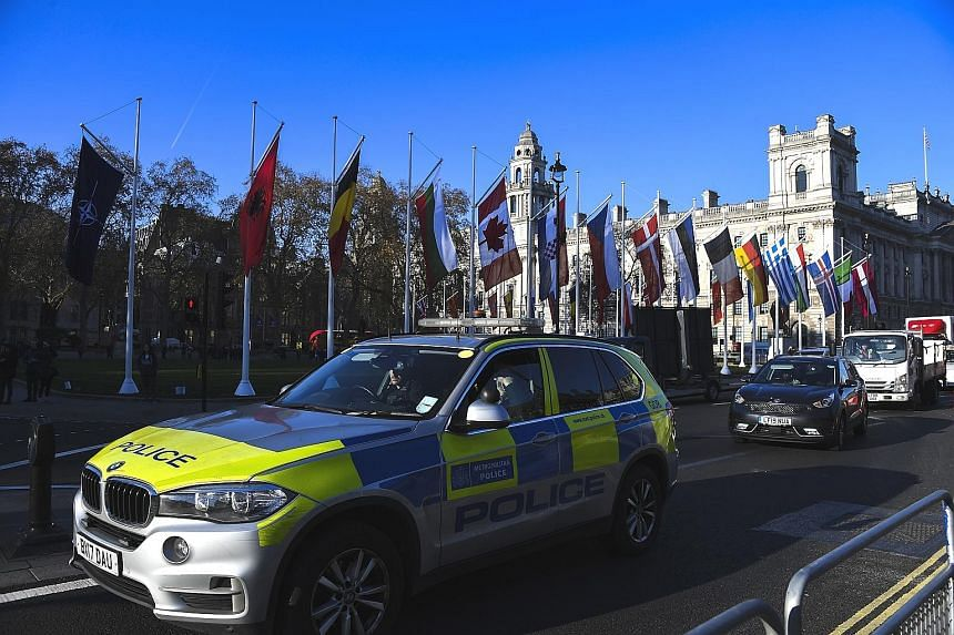 Flags of Nato member states in London, ahead of the group's summit today. The world's biggest military alliance marks its 70th birthday while battling one of its most confounding adversaries - itself. PHOTO: ASSOCIATED PRESS