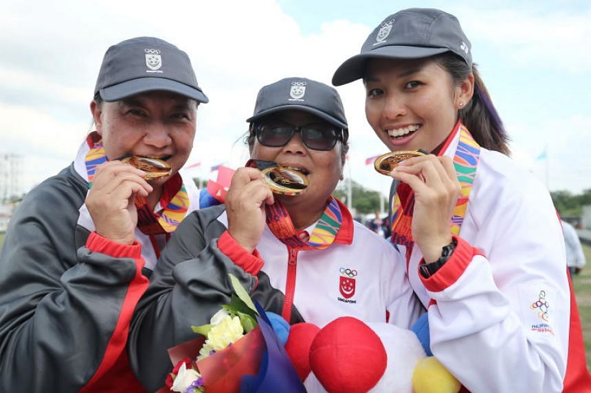 (From left) Singapore's Goh Quee Kee, Lim Poh Eng and Shermeen Lim won the women's triples gold in lawn bowls at the SEA Games held in the Philippines on Dec 4, 2019.