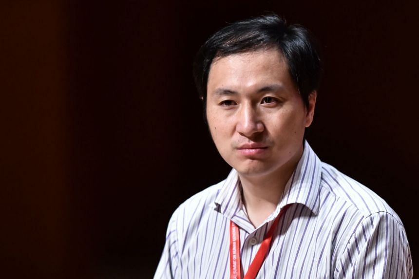 Chinese scientist He Jiankui reacts during a panel discussion at the Second International Summit on Human Genome Editing in Hong Kong in 2018.