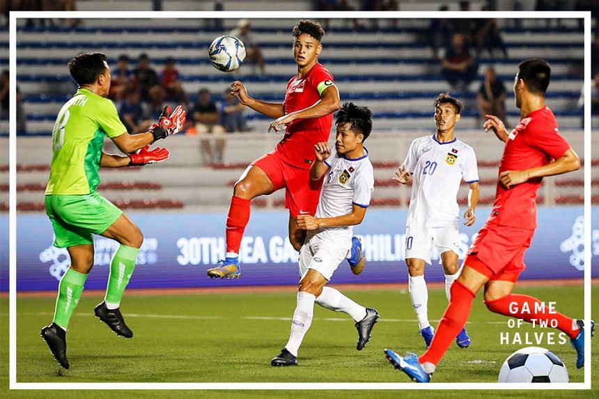 Irfan Fandi (C) of Singapore in action during the SEA Games 2019 men's soccer first round match between Laos and Singapore in Manila, Philippines, 26 November 2019