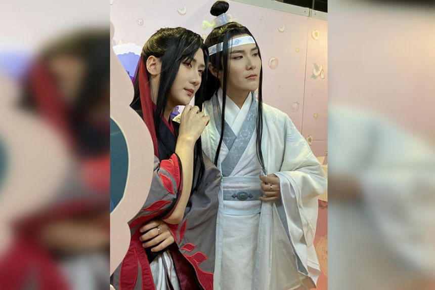 Cosplayers Baozi (right) and Hana at the Flower Knows booth on the last day of the Anime Festival Asia, dressed as Wei Wuxian and Lan Wangji from the popular Chinese novel series Mo Dao Zu Shi.