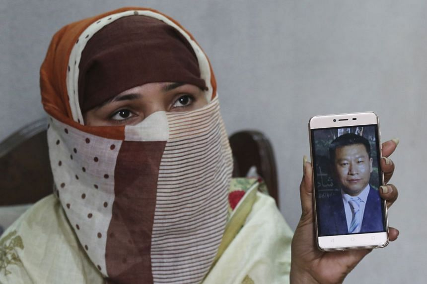 Sumaira, a Pakistani woman, shows a picture of her Chinese husband in Gujranwala, Pakistan. Sumaira, who didn't want her full name used, was raped repeatedly by Chinese men at a house in Islamabad where she was brought to stay after her brothers arra