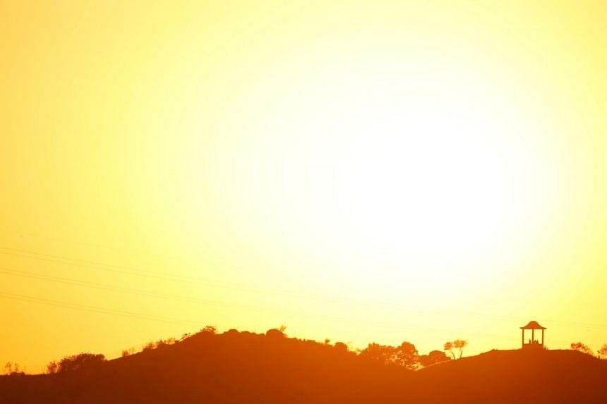 The sun sets at El Mirador de la Alemana as a heatwave hits Spain, in Malaga, southern Spain, on July 24, 2019.