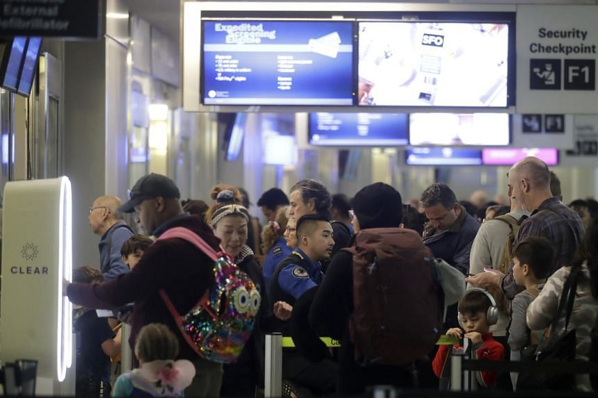 Passengers wait to pass through security gates at San Francisco International Airport, on Nov 26, 2019. American citizens are allowed to opt out of being photographed.