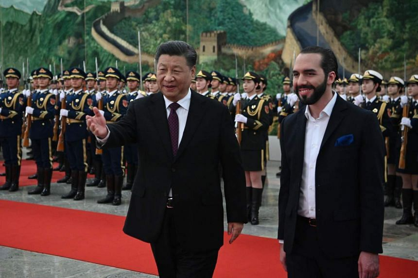 China's President Xi Jinping walks with El Salvador's President Nayib Bukele during a welcoming ceremony at the Great Hall of the People in Beijing, on Dec 3, 2019.