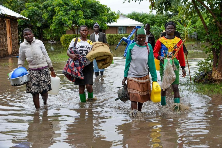 Displaced families flee to higher ground in K'akola village in Nyando sub-county in Kisumu, after their houses were flooded on Dec 3, 2019.