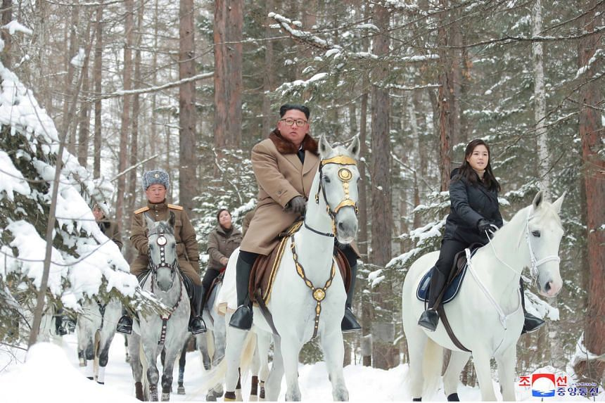 The Korean Central News Agency released photos on Dec 4, 2019, showing North Korean leader Kim Jong Un riding a white horse to snow-covered Mount Paektu along with his wife and other officials.