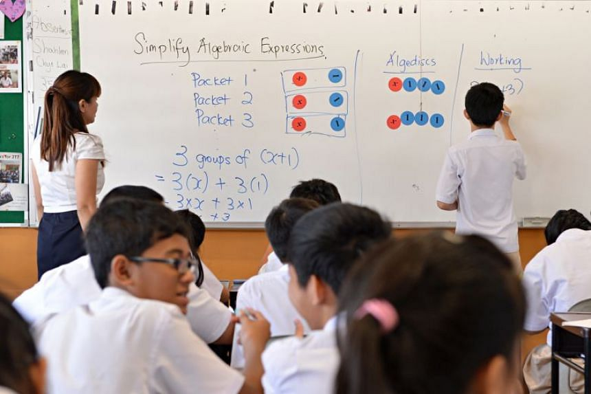 Bedok View Secondary School students learning algebra. In the latest Programme for International Student Assessment, Singapore came in second place in all three subjects covered in the study - mathematics, science and reading.